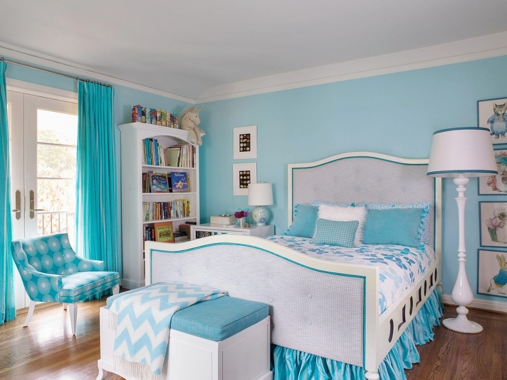 Mid-sized transitional girl medium tone wood floor and brown floor kids' room photo in San Francisco with blue walls