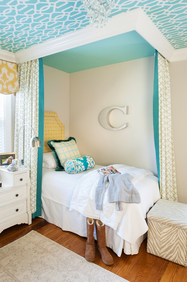 Inspiration for a transitional girl medium tone wood floor kids' room remodel in Richmond with beige walls