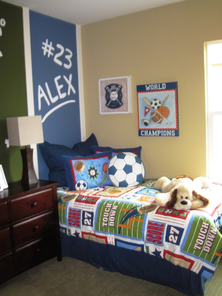 Kids' room - contemporary boy carpeted kids' room idea in San Diego with yellow walls