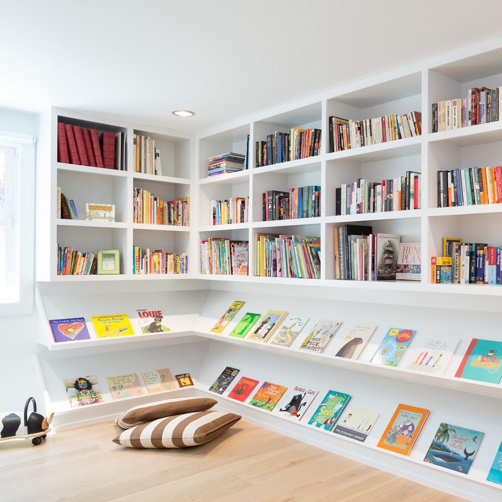 Playroom - contemporary gender-neutral light wood floor playroom idea in Denver
