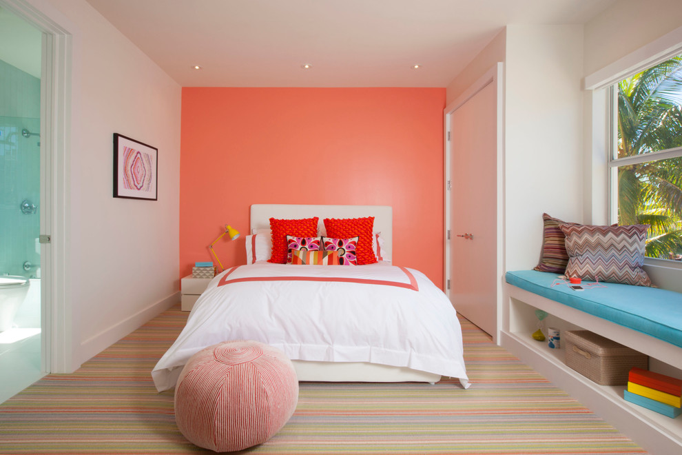 Inspiration for a contemporary girl carpeted kids' room remodel in Miami with pink walls