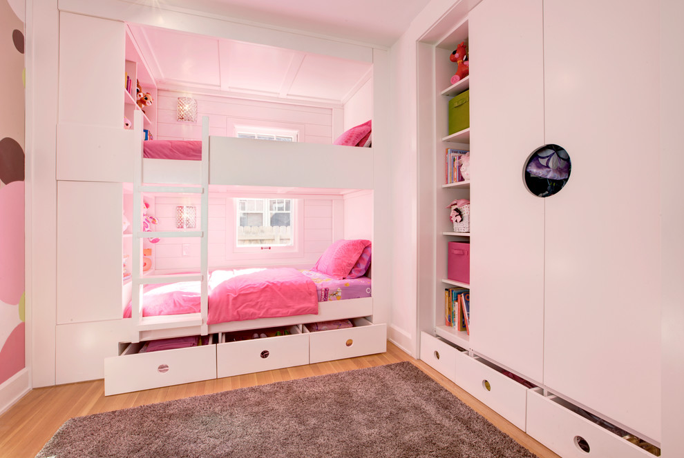 Example of a small trendy girl light wood floor kids' room design in Indianapolis with white walls