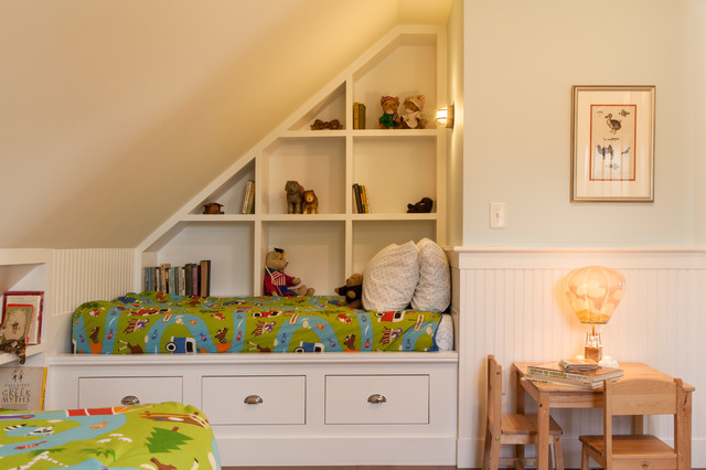 Example of a mid-sized classic boy medium tone wood floor and brown floor kids' room design in Boston with beige walls