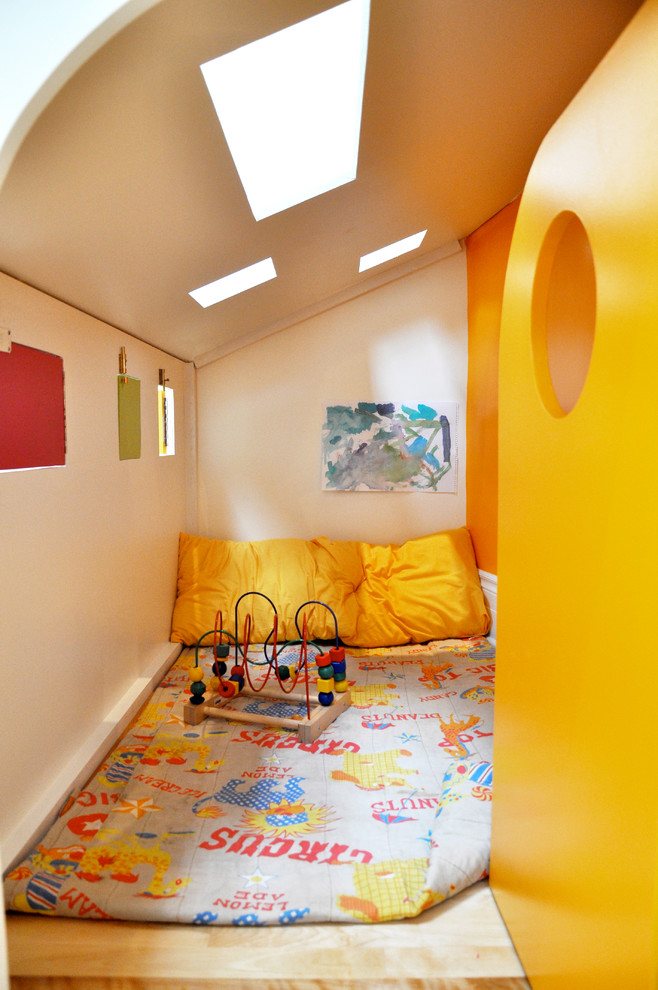 Inspiration for a modern playroom remodel in Montreal with multicolored walls