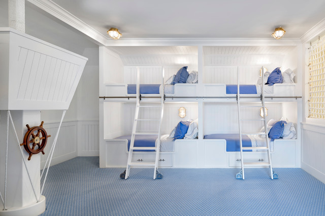 Coastal gender-neutral carpeted kids' bedroom photo with white walls