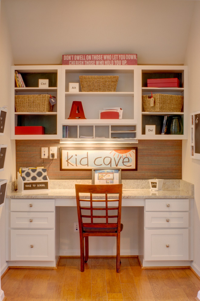 Inspiration for a timeless gender-neutral medium tone wood floor kids' study room remodel in Other with white walls