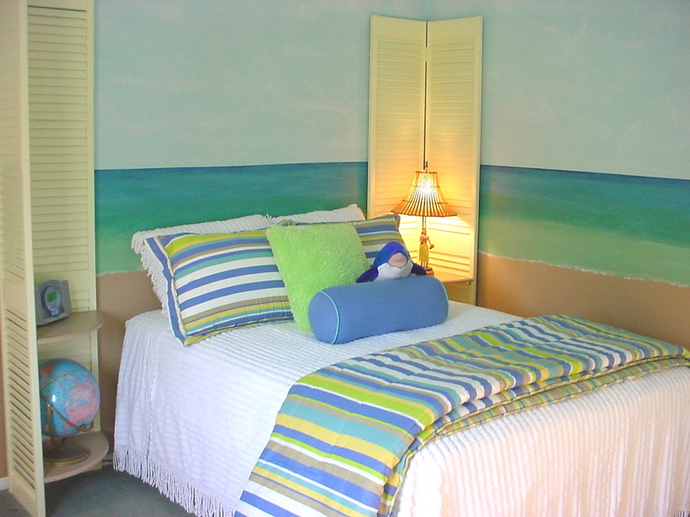 Inspiration for a mid-sized coastal gender-neutral carpeted kids' room remodel in Los Angeles with multicolored walls