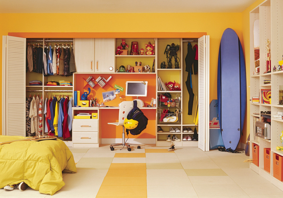 Example of a classic boy multicolored floor kids' room design in New York with yellow walls