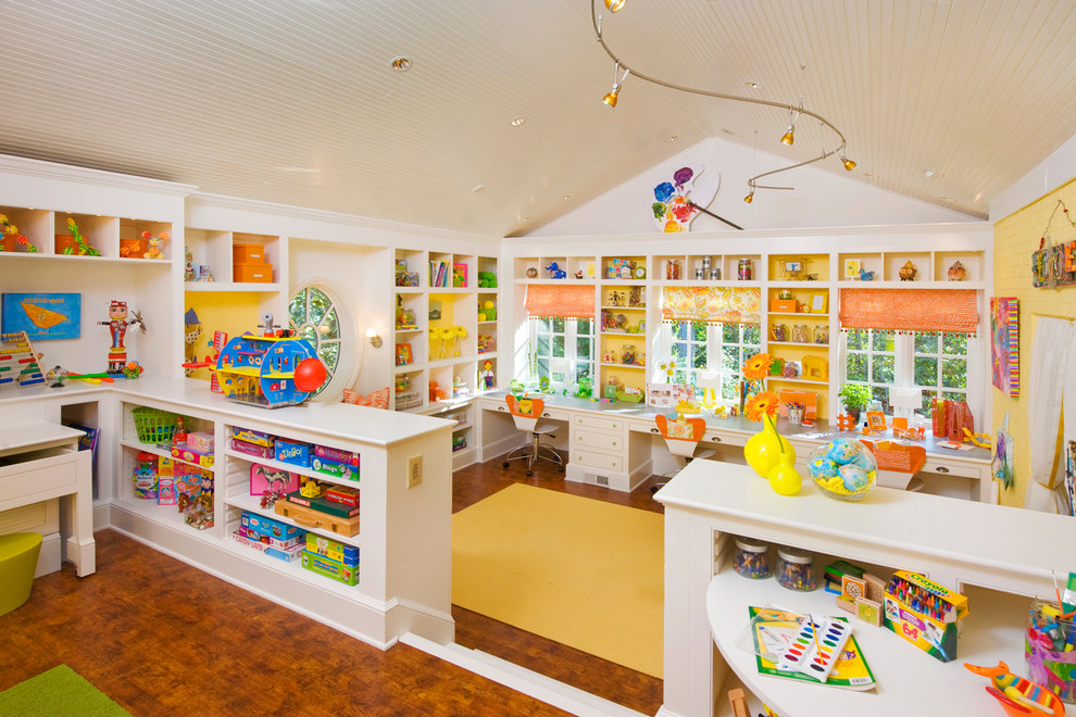 Large transitional gender-neutral medium tone wood floor playroom photo in Atlanta with white walls
