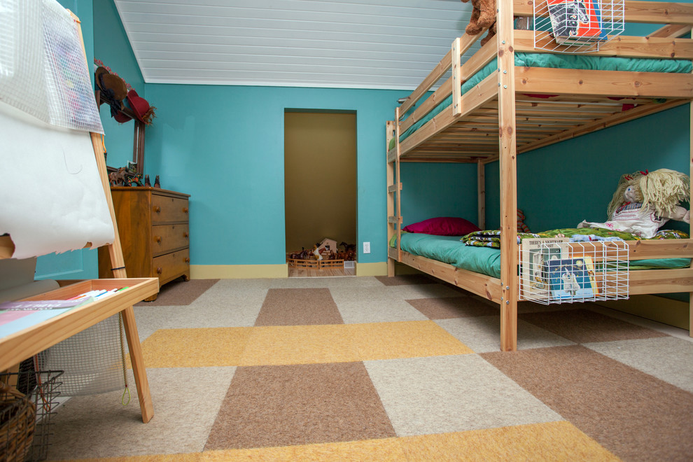 Mid-sized eclectic gender-neutral kids' room photo in Portland with blue walls