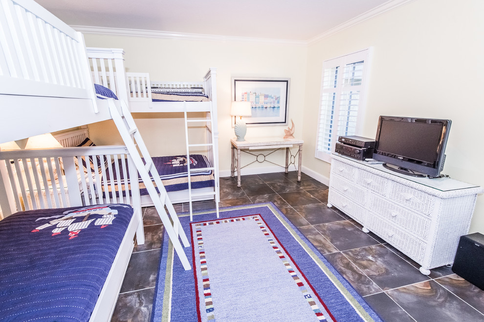 Large beach style gender-neutral kids' room photo in Miami with beige walls