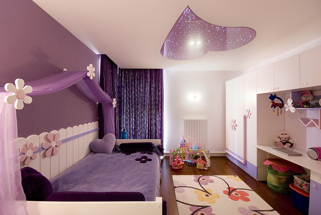 Trendy kids' room photo in Other with multicolored walls