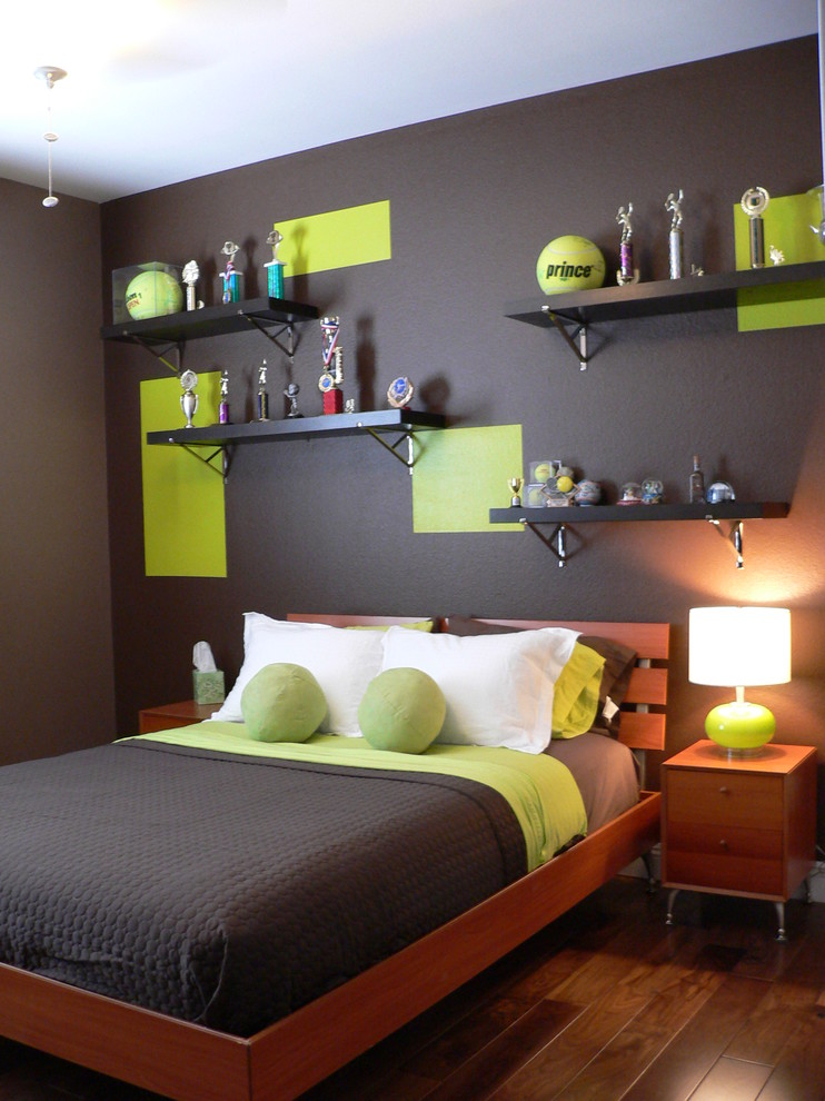 Kids' room - contemporary medium tone wood floor and brown floor kids' room idea in Las Vegas with multicolored walls