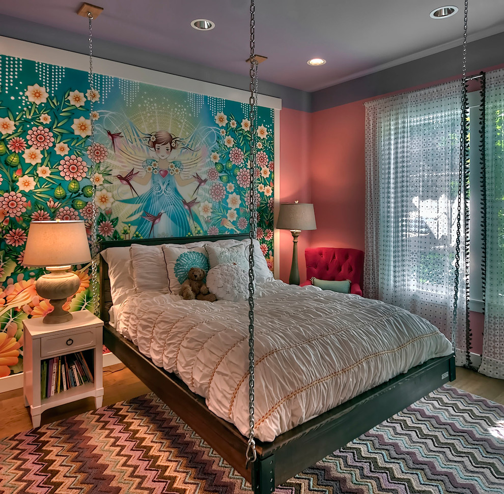 Example of a transitional girl medium tone wood floor kids' room design in Seattle with multicolored walls