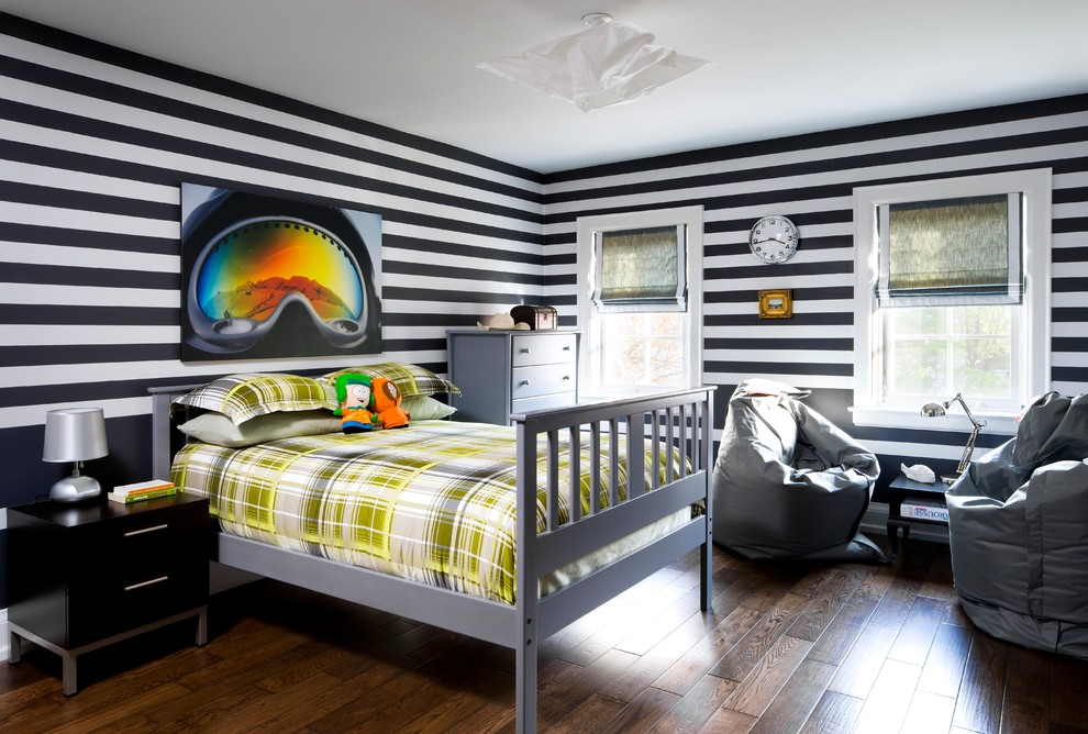 Kids' room - large contemporary boy dark wood floor kids' room idea in Toronto with multicolored walls
