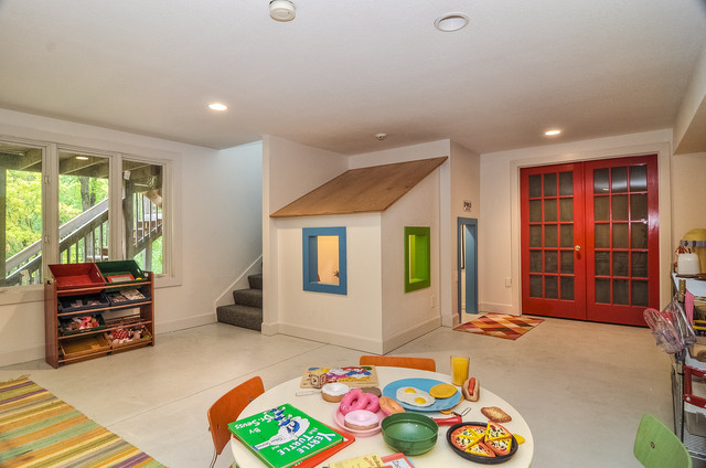 Trendy gender-neutral playroom photo in Kansas City with white walls