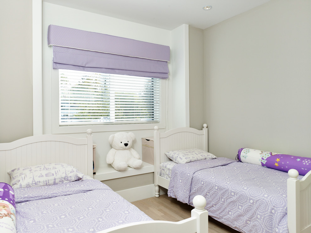 Kids' room - contemporary light wood floor kids' room idea in Vancouver with gray walls