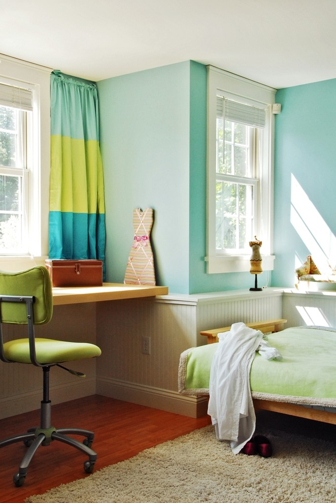 Example of a trendy girl kids' room design in Burlington with blue walls