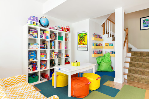 homeschool area at the bottom of stairs with a table, storage cubbies, and reading nook