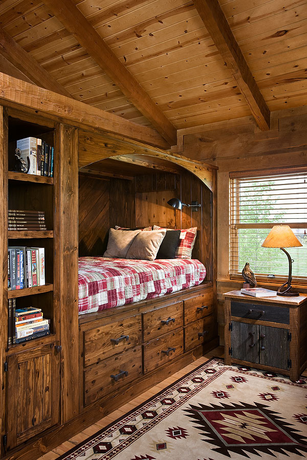 Example of a mid-sized classic boy medium tone wood floor and brown floor kids' room design in Nashville with brown walls