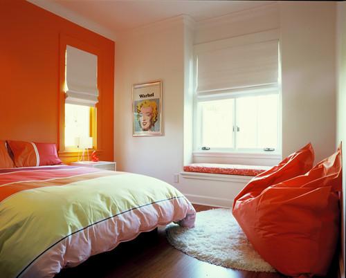 dormitorio alegre decorado en naranja