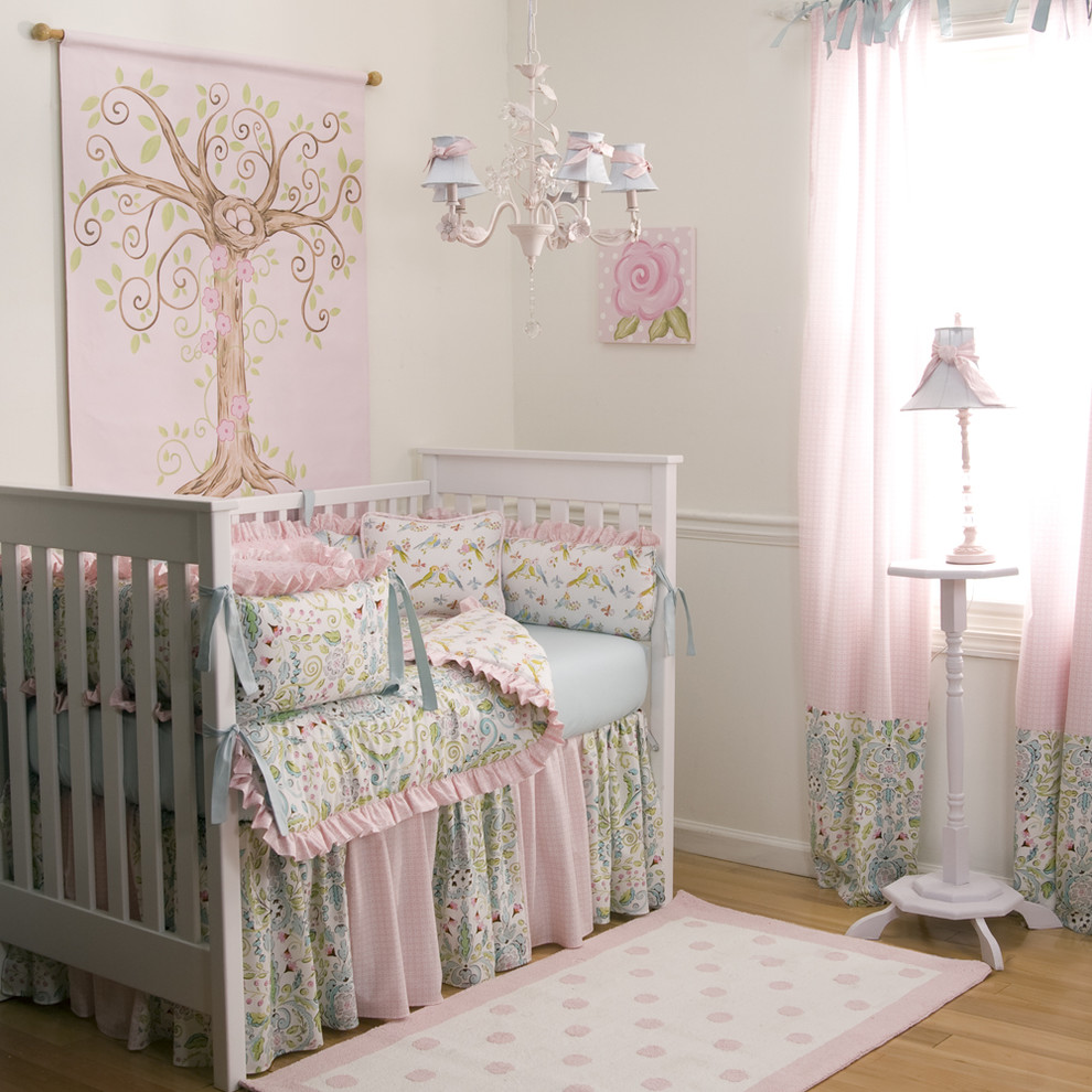 Kids' room - traditional girl light wood floor kids' room idea in Atlanta with white walls