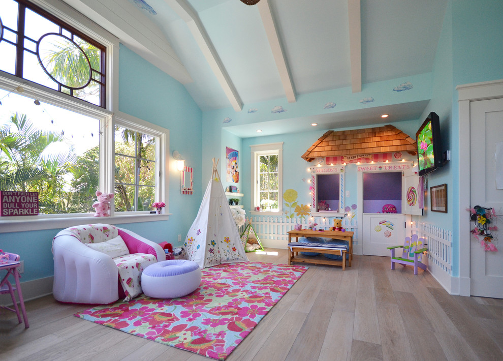 Example of a mid-sized beach style girl light wood floor kids' room design in Tampa with blue walls