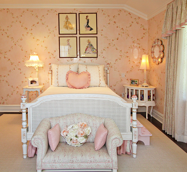Cottage chic girl dark wood floor kids' room photo in New York with pink walls