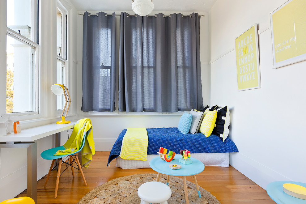 Mid-sized danish boy medium tone wood floor kids' bedroom photo in Sydney with white walls