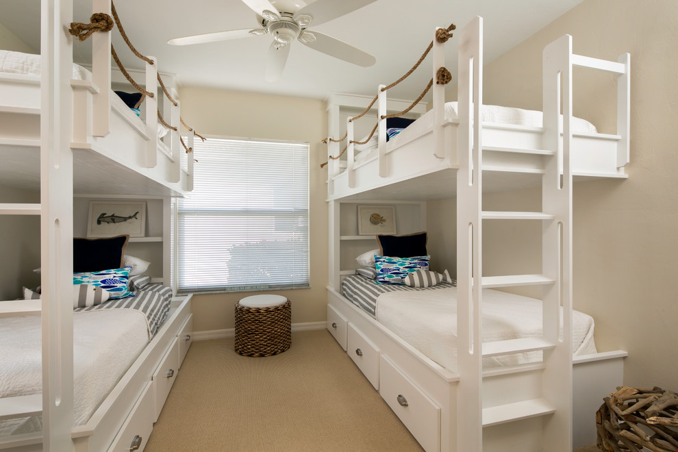Inspiration for a coastal gender-neutral carpeted kids' bedroom remodel in Tampa with beige walls