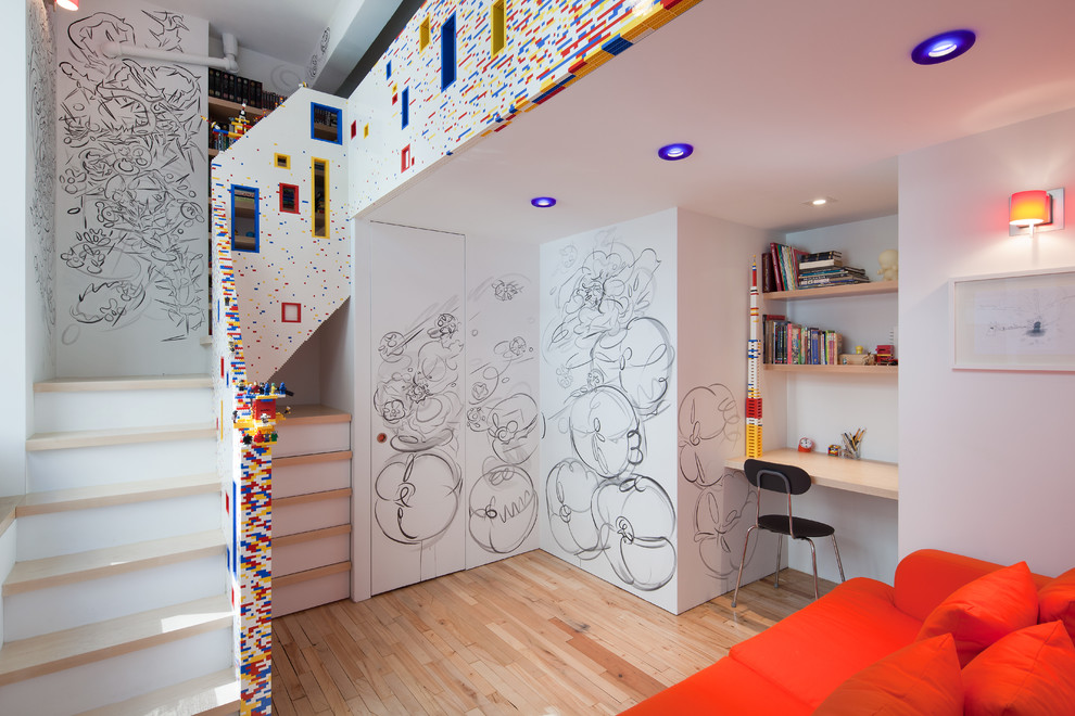 Inspiration for a contemporary boy light wood floor kids' room remodel in New York with white walls