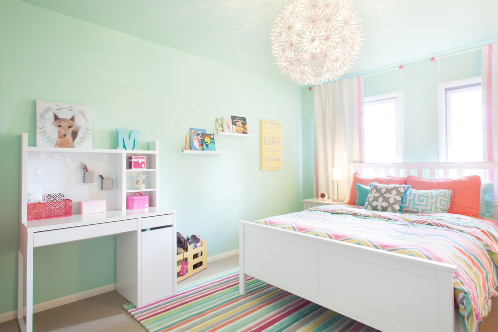 Kids' room - mid-sized contemporary girl carpeted kids' room idea in Portland with blue walls