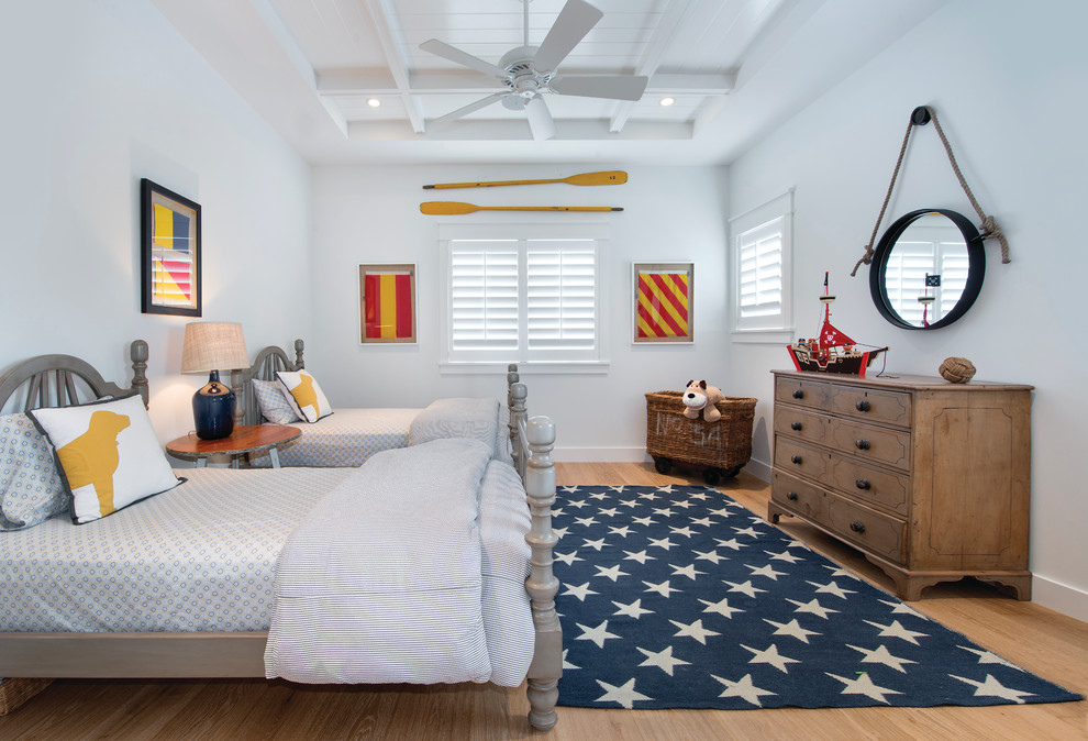 Inspiration for a coastal boy light wood floor kids' room remodel in Miami with white walls