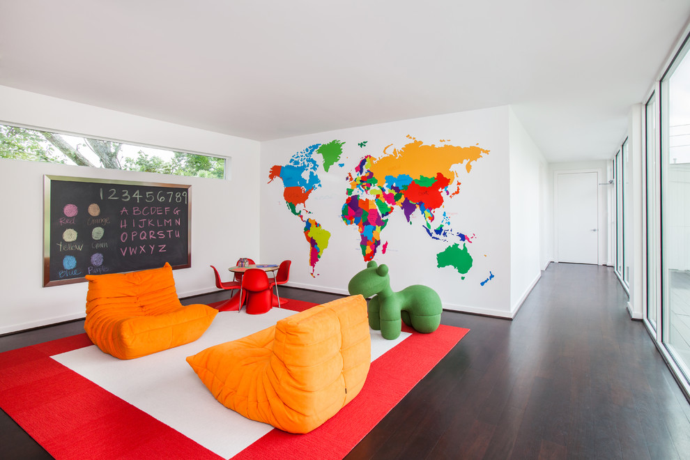 Inspiration for a large contemporary gender-neutral dark wood floor kids' room remodel in Houston with white walls