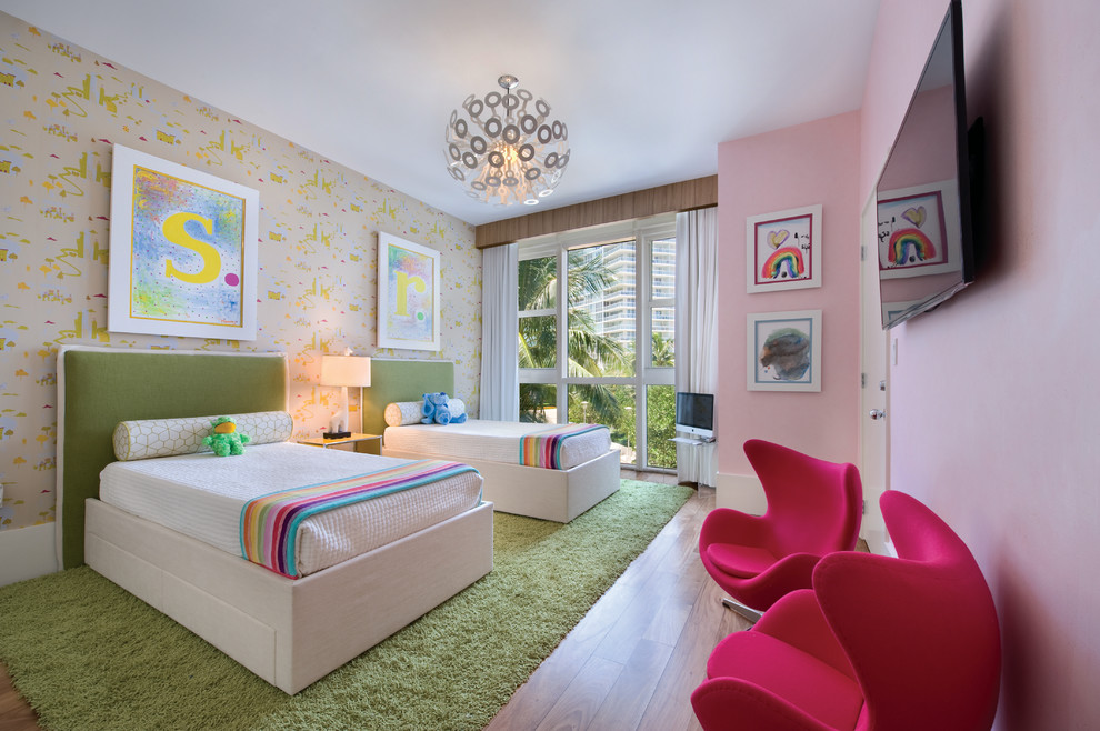 Example of a trendy medium tone wood floor kids' room design in Miami with multicolored walls