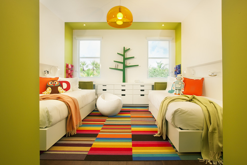 Trendy gender-neutral carpeted kids' bedroom photo in Miami with multicolored walls