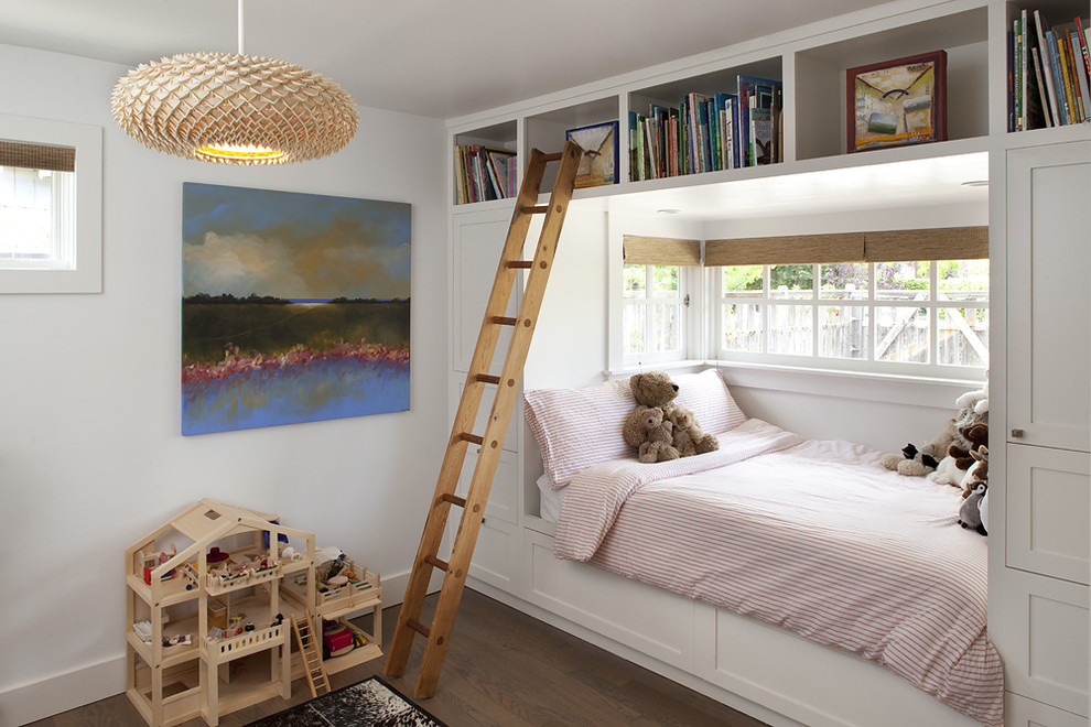 Kids' room - contemporary gender-neutral dark wood floor kids' room idea in San Francisco with white walls