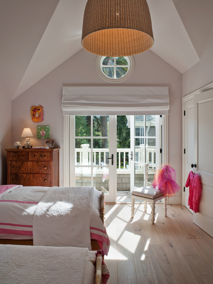 Elegant girl light wood floor kids' room photo in San Francisco with gray walls