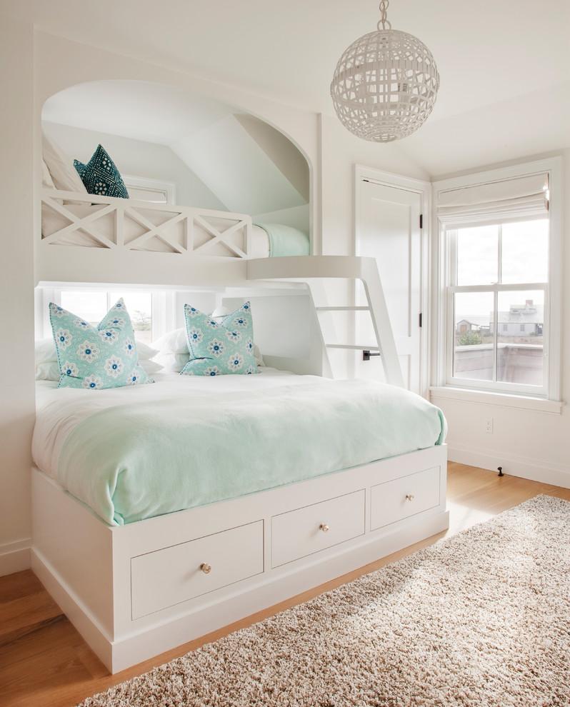 Kids' room - coastal girl light wood floor and beige floor kids' room idea in Boston with white walls