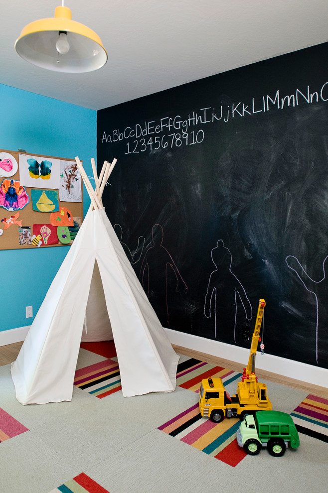 Inspiration for an eclectic boy kids' room remodel in Other with multicolored walls