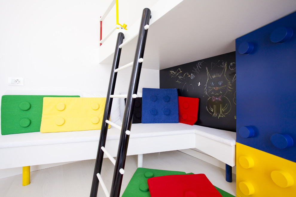 Inspiration for a modern gender-neutral playroom remodel in Other with white walls
