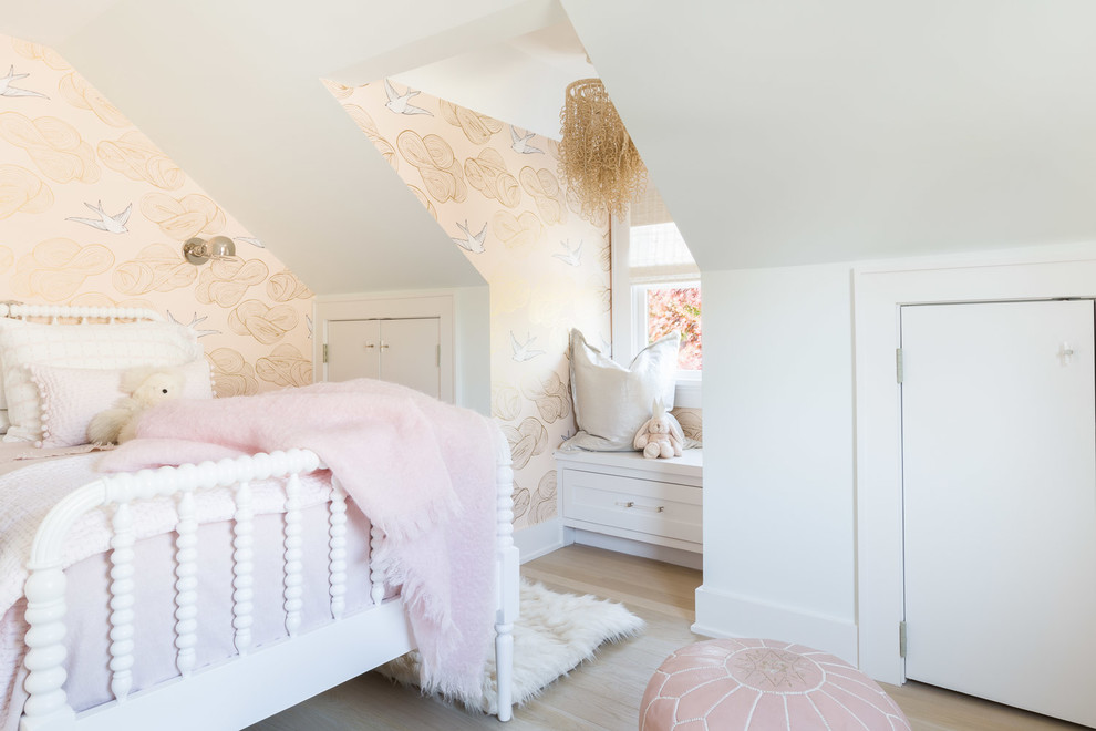 Example of a beach style girl light wood floor and beige floor kids' room design in New York with multicolored walls