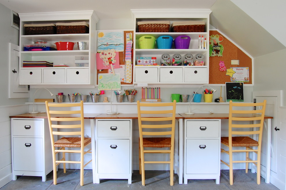Example of a farmhouse gender-neutral kids' study room design in New York with white walls