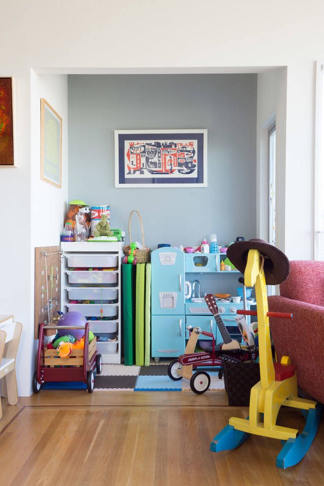 Small trendy girl light wood floor kids' room photo in San Francisco with gray walls