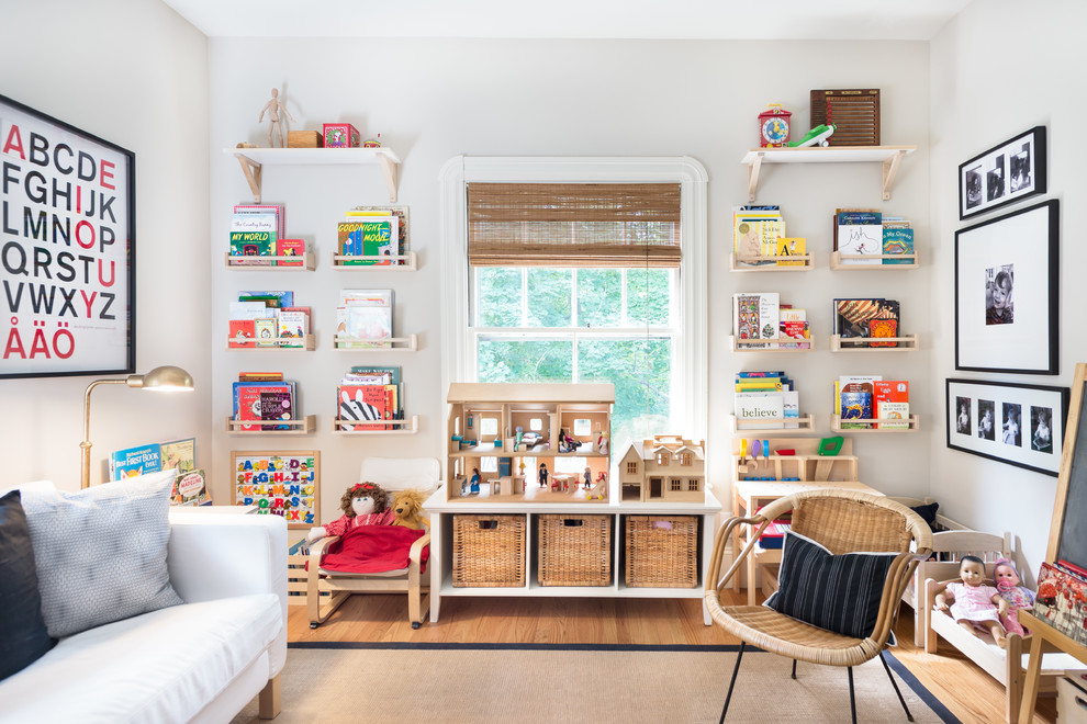 Inspiration for a country girl medium tone wood floor kids' room remodel in Boston with white walls