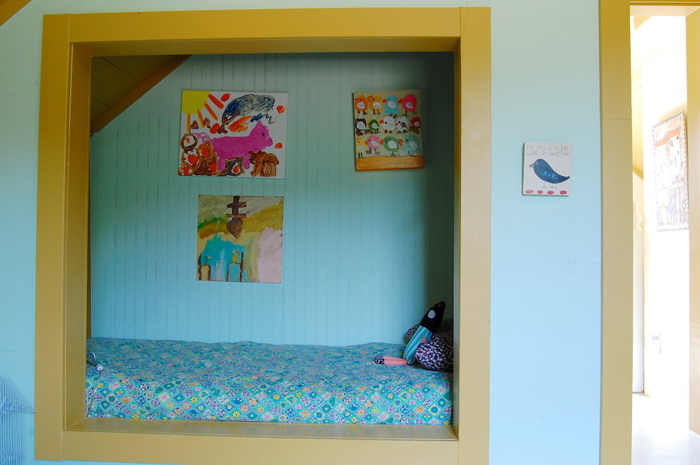 Example of a country girl kids' room design in New York with blue walls