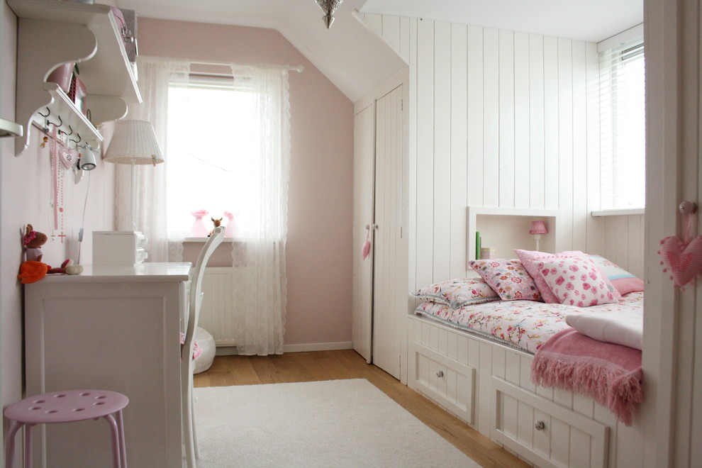 Inspiration for a contemporary girl light wood floor kids' room remodel in Amsterdam with pink walls