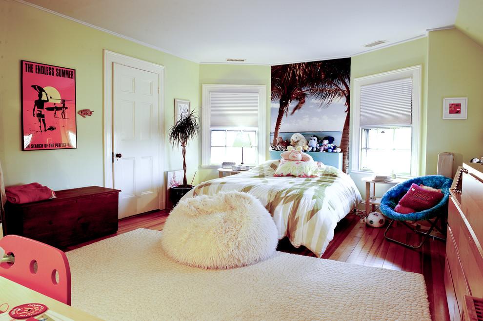 Example of a trendy girl medium tone wood floor and brown floor kids' room design in Boston with green walls