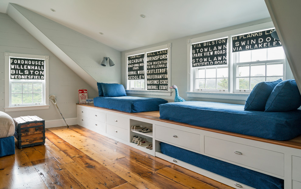 Kids' bedroom - mid-sized coastal boy medium tone wood floor kids' bedroom idea in New York with gray walls