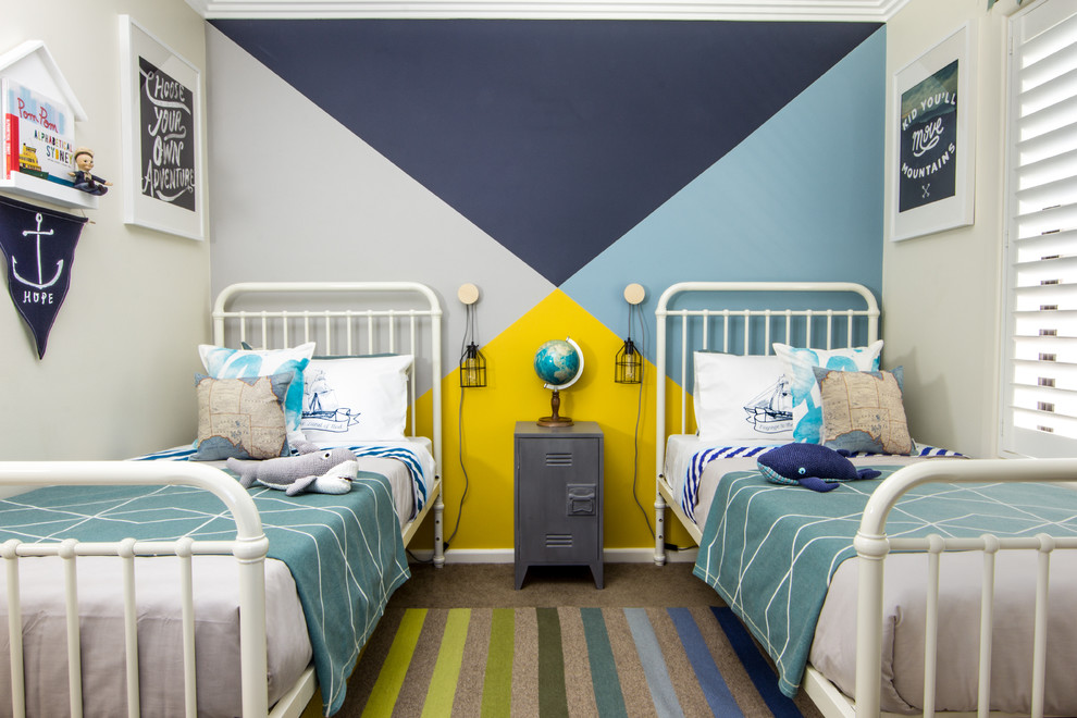 Mid-sized coastal boy carpeted kids' bedroom photo in Sydney with multicolored walls